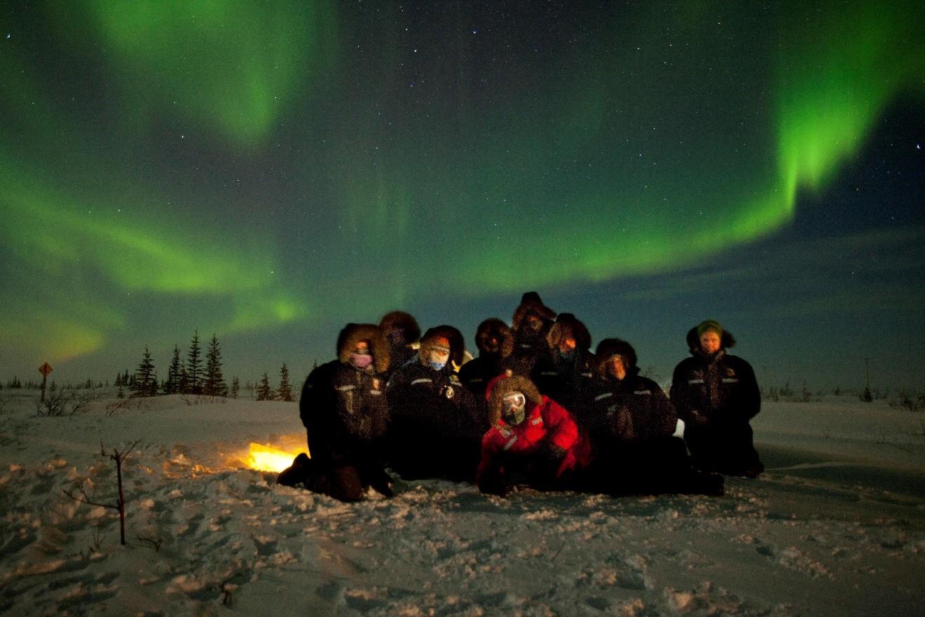 Natural Habitat Group under the Northern Lights