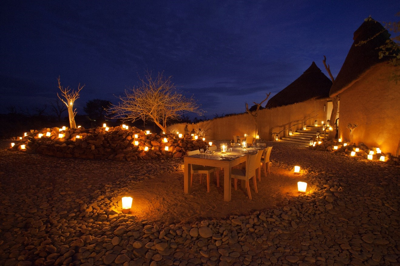 a blue hour photo of little kulala lodge at dinner time