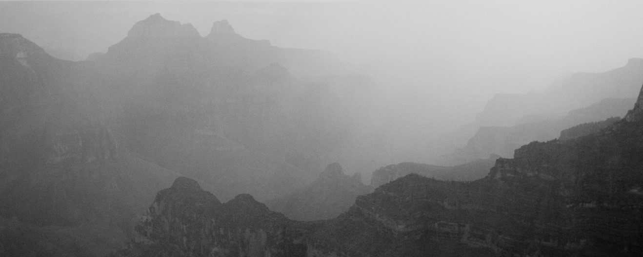 a black and white photo of part of the grand canyon