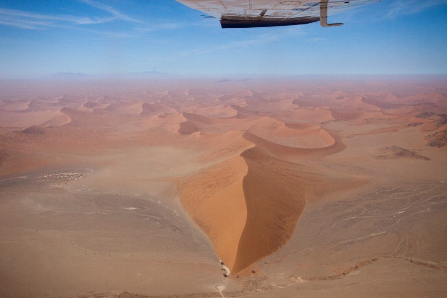 a bird's eye view of Namibia's sand dunes from a small charter flight over the sand dune sea