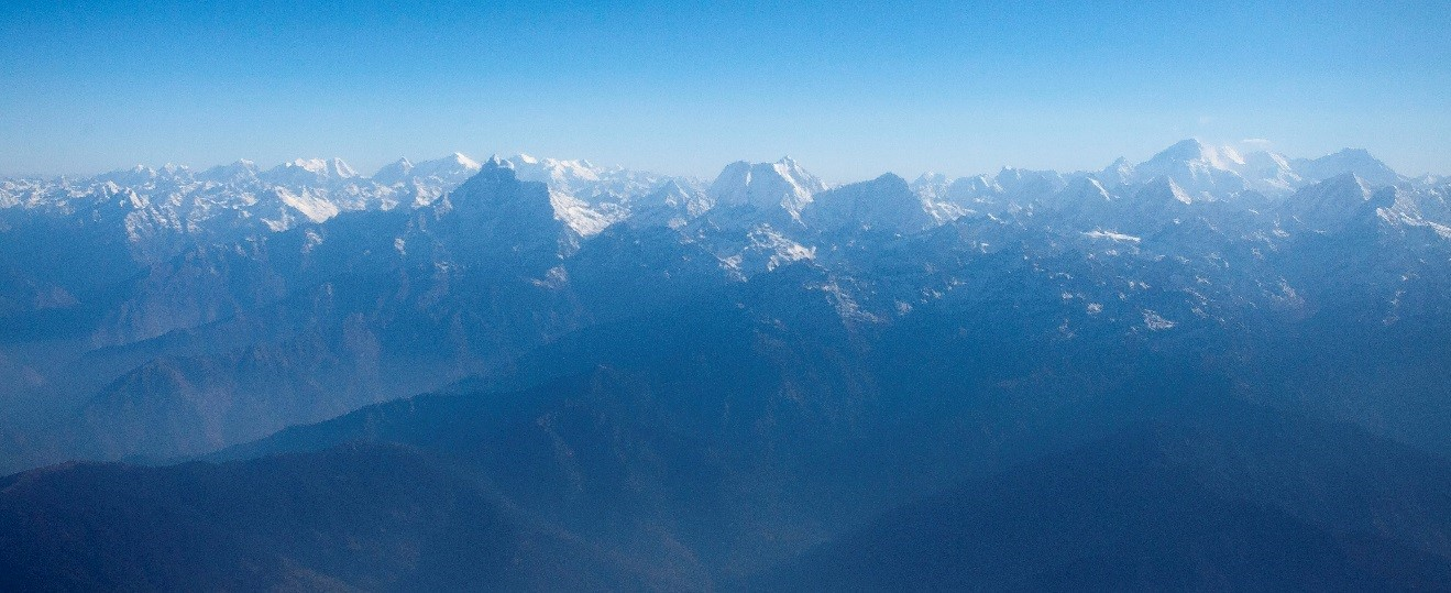 a view of the himalayas from an airplane window