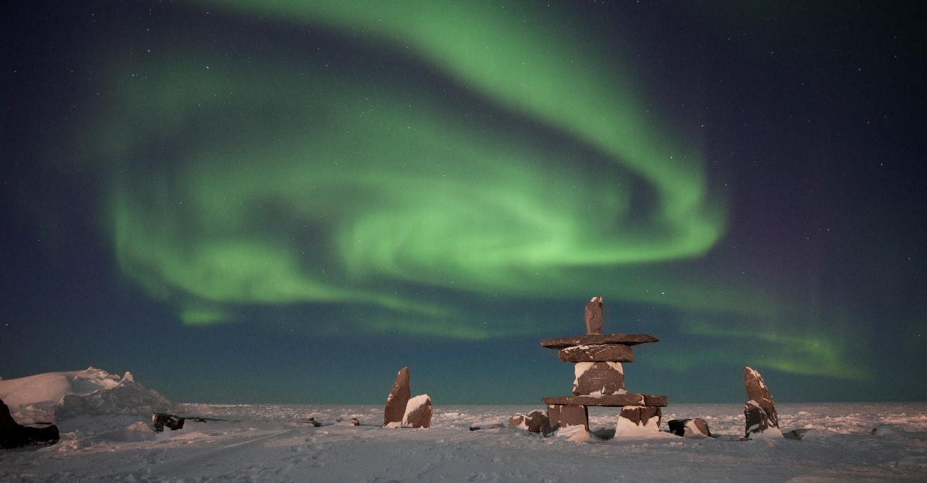 a stunning swirling aurora over the churchill inushuk on the shores of hudson bay