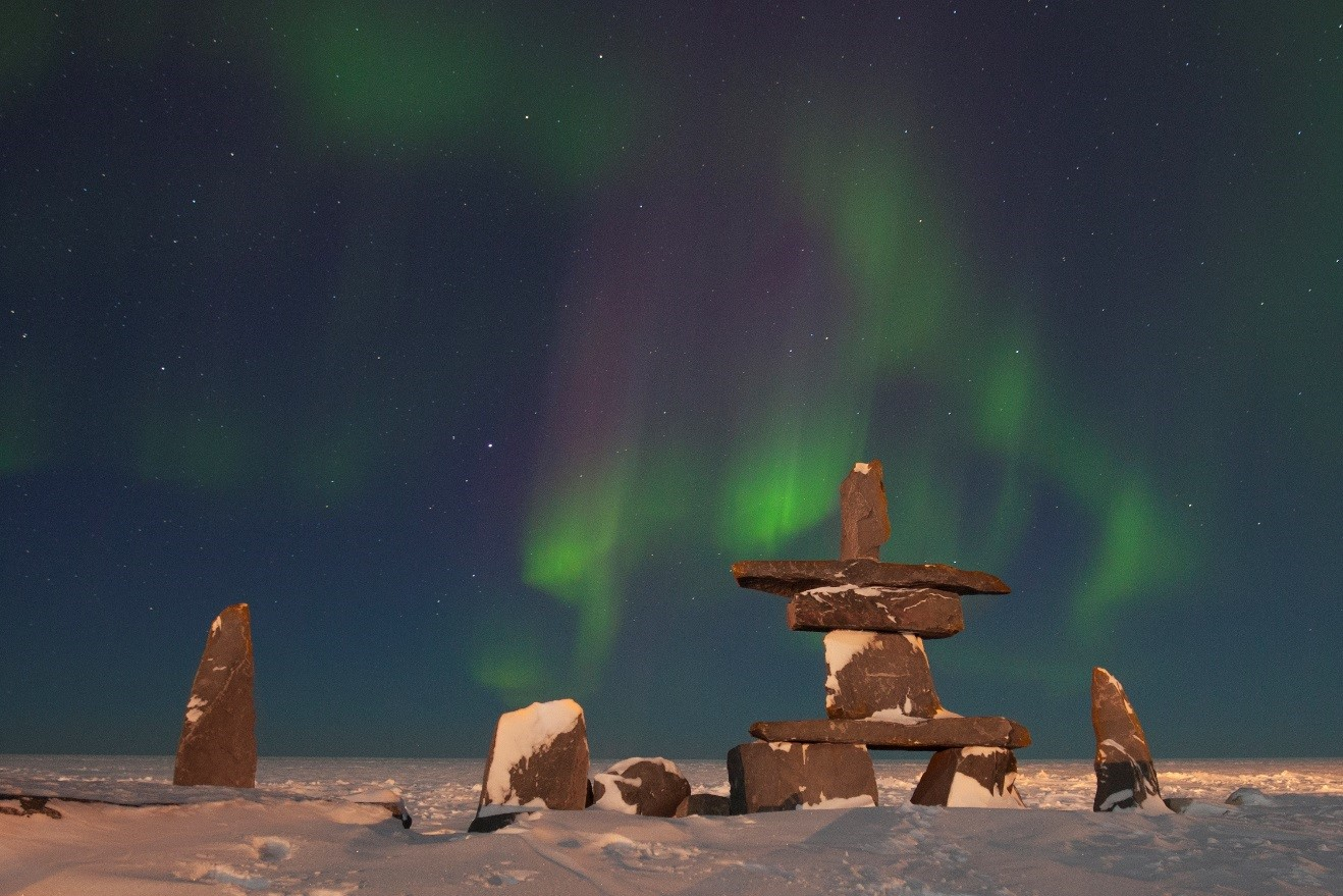 green and red aurora dances over the hudson bay in Churchill, Canada