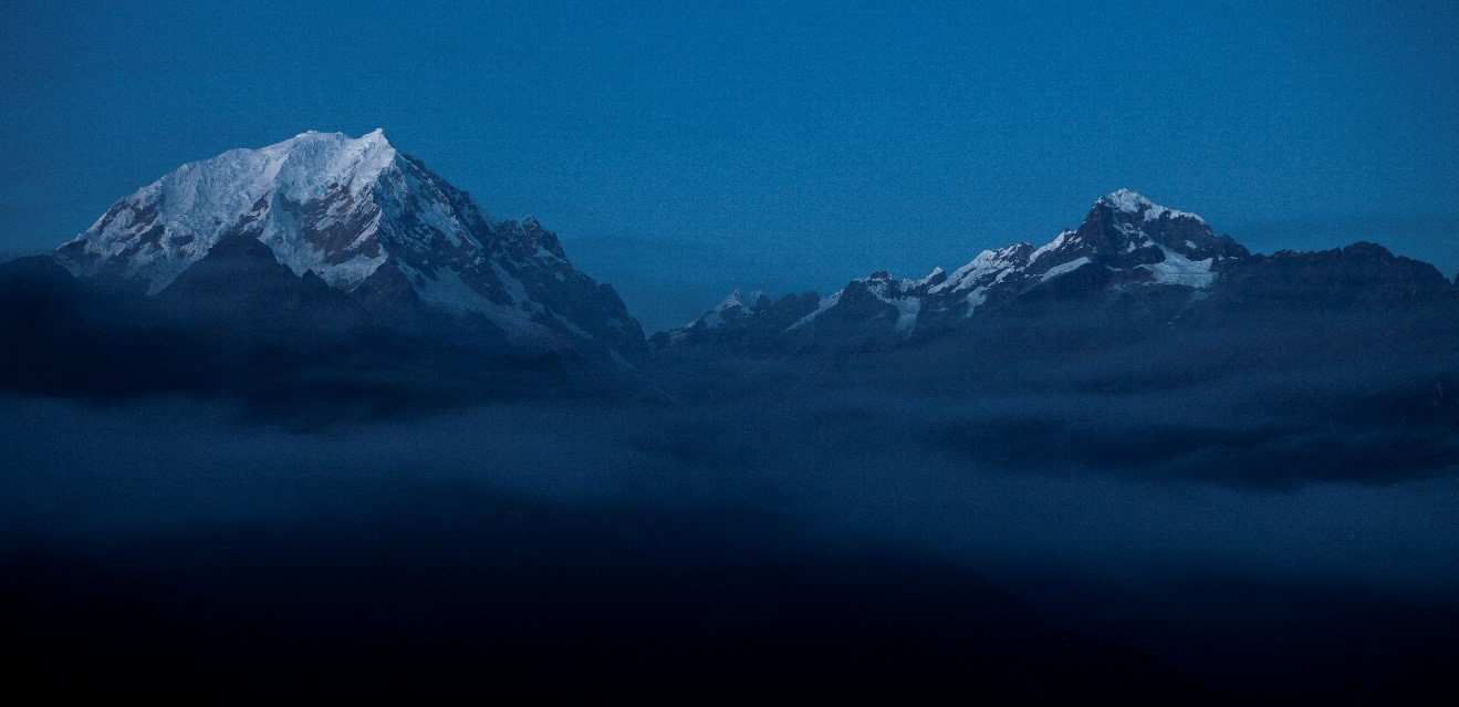 the salkantay range of the andes in early morning blue dawn light