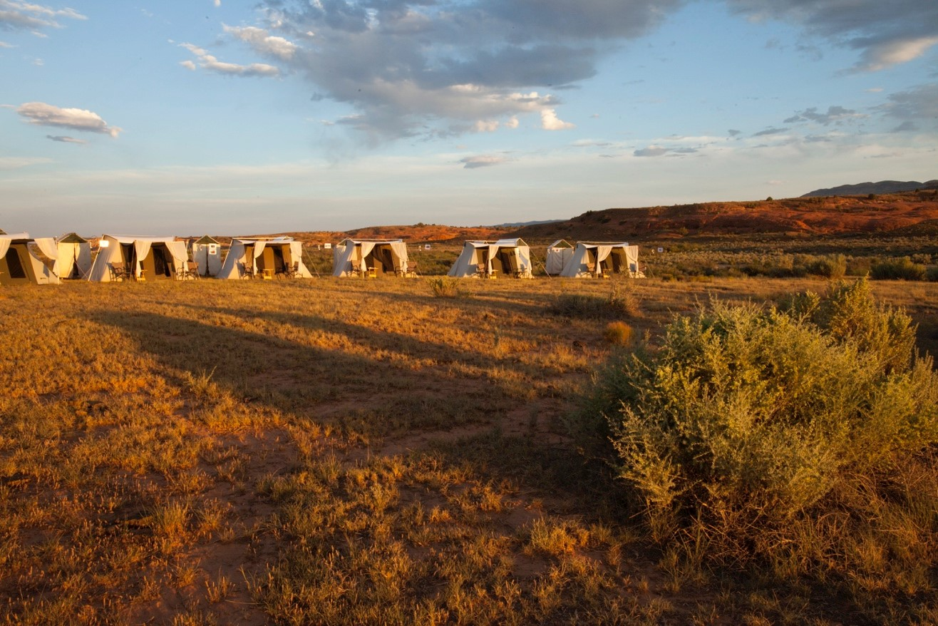 a series of tents set up at camp in Escalante National Monument
