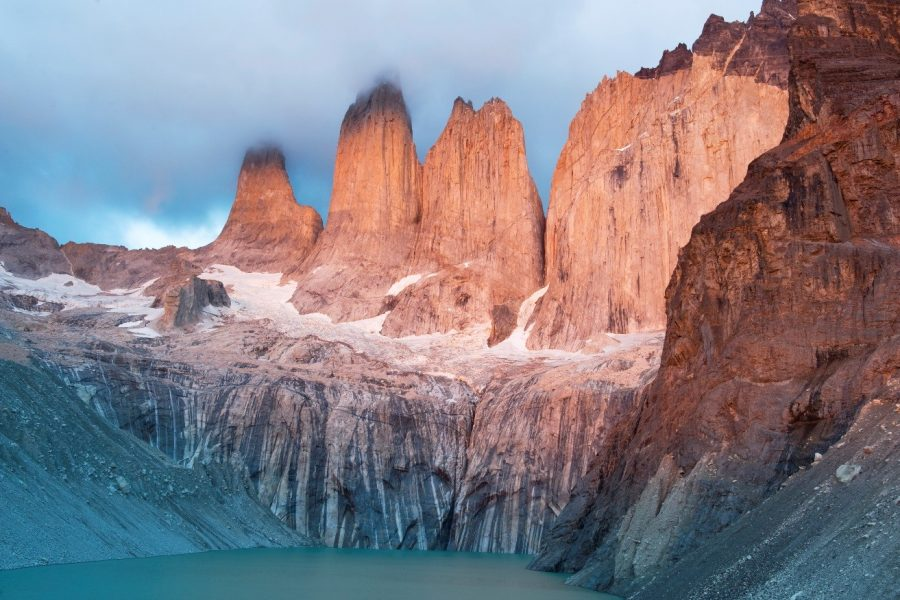 a stunning photo of peaks in patagonia with beautiful light