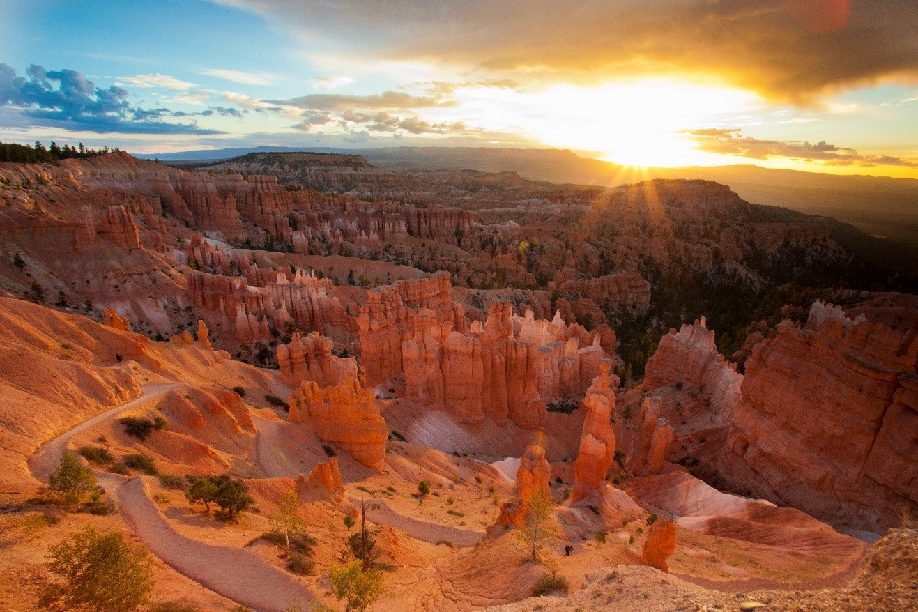 a special photo of bryce canyon at sunrise with sunburst over the horizon