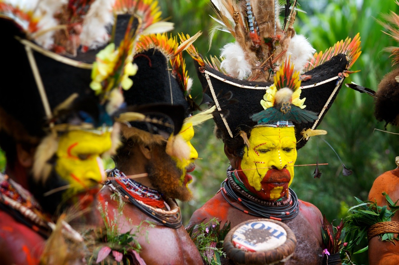 three huli warriors assemble for a sing sing in papua new guinea