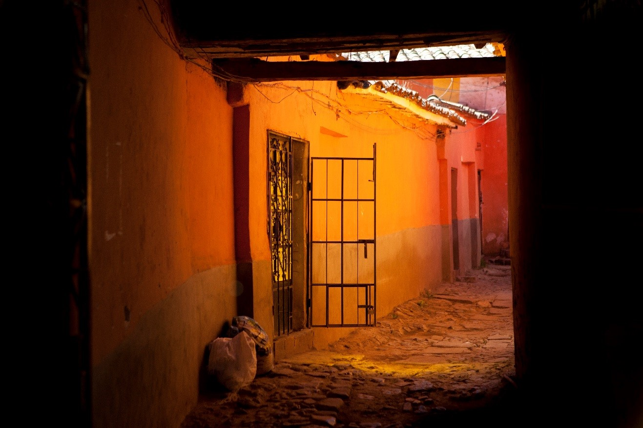 a dark yet colorful alleyway in Cusco is an alluring travel photo