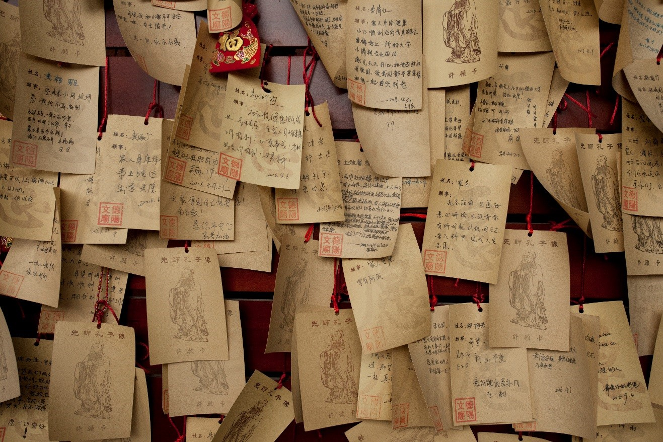 Buddhist scrolls are tacked outside of a monastery in rural china