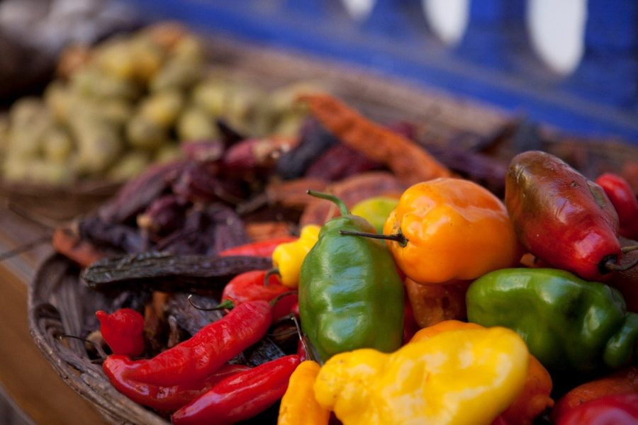 a colorful photo of peppers and other foods at a restaurant in Cusco