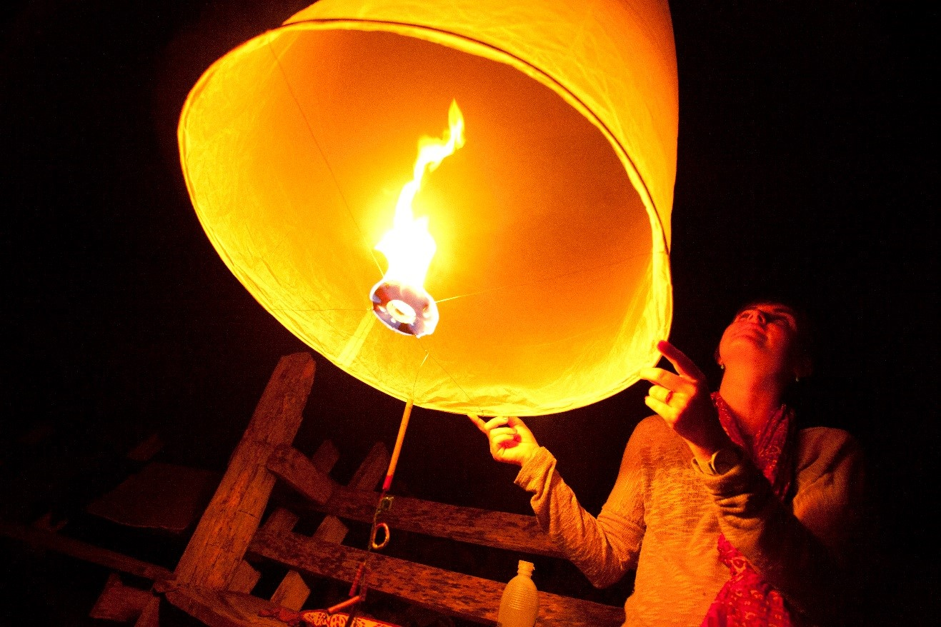 a wide-angle photo of a lantern about to be released in Thailand