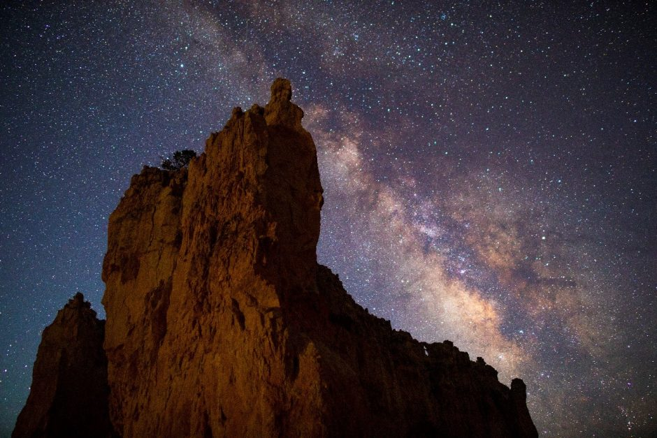 a night photo of the milky way over bryce canyon national park