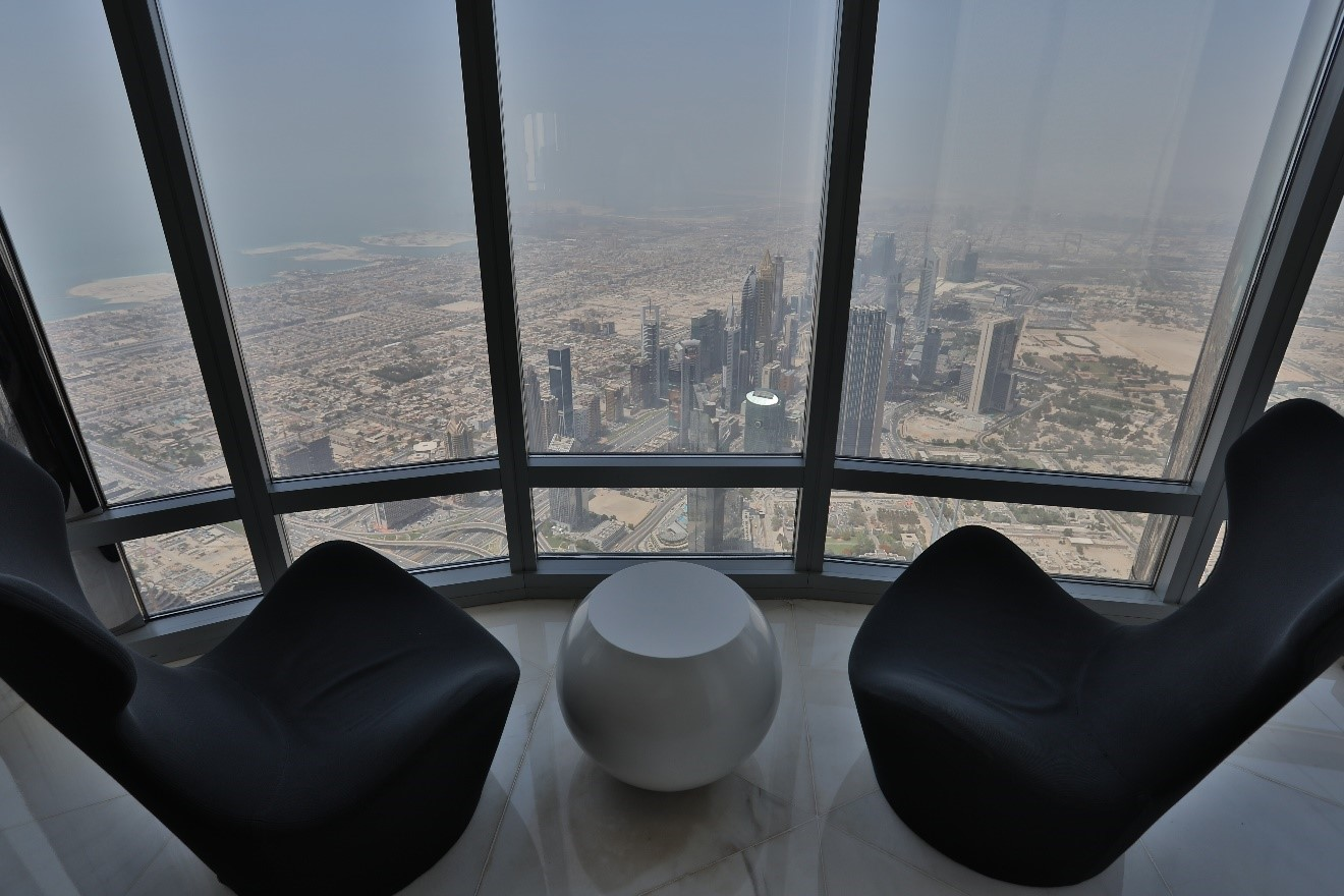 a view from inside the burj khalifa with chairs looking out