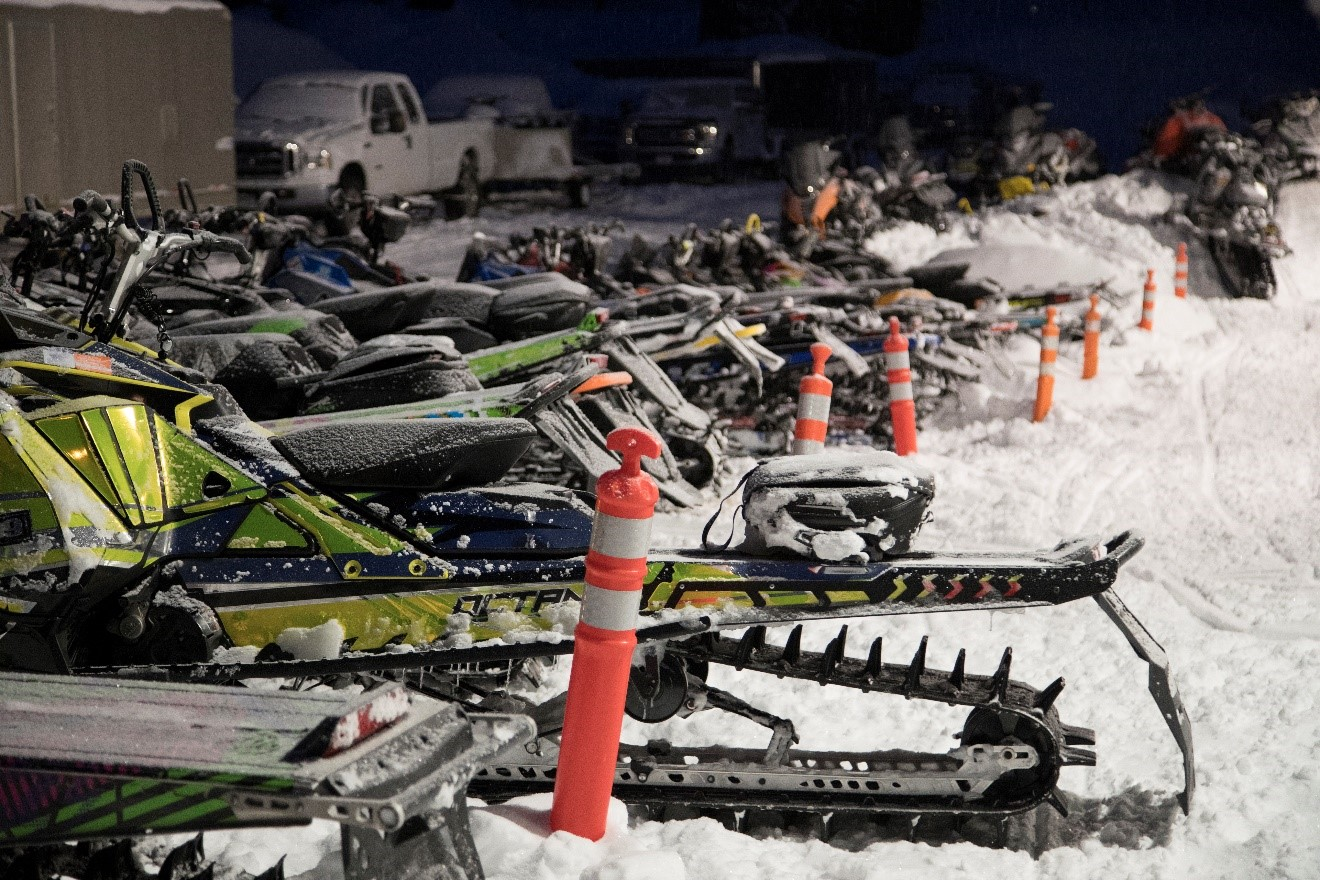 a parking area for snow mobiles is an interesting scene in cooke city