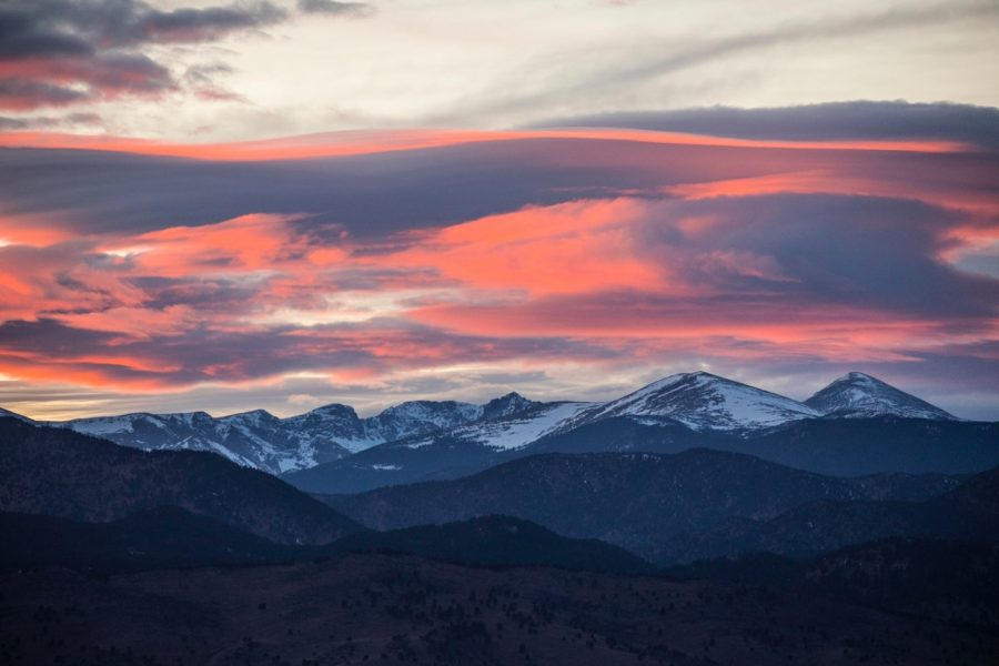 a pink sunset over the rocky mountains