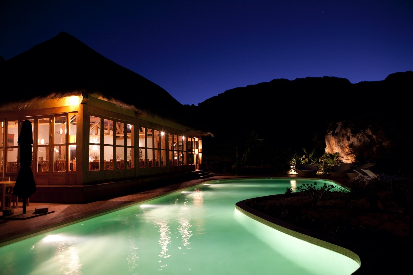 the glow of the pool lights up a lodge in madagascar