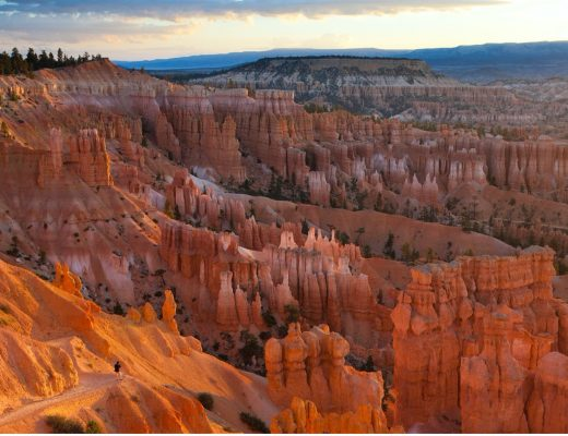 a sweeping view of bryce canyon at sunrise